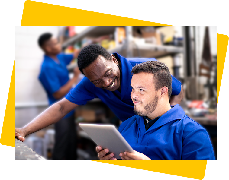 Two men employees smiling at each other in the workplace